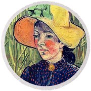 Young Peasant Girl In A Straw Hat Sitting In Front Of A Wheatfield Round Beach Towel