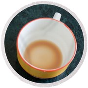 Round Beach Towel featuring the photograph A Cup With The Remains Of Tea On A Green Table by Ashish Agarwal