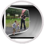 Round Beach Towel featuring the photograph Chasing Bubbles by Brian Wallace