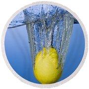Lemon Dropped In Water Round Beach Towel