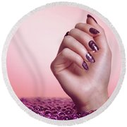 Woman Hand With Purple Nail Polish Round Beach Towel