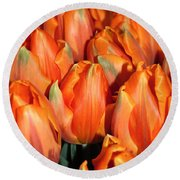 A Field Of Orange Tulips Round Beach Towel by Eva Kaufman