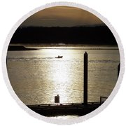 A Lone Boat At Sunset Round Beach Towel