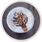 Round Beach Towel featuring the photograph A Lot Of Cigarettes Stubbed Out At A Garbage Bin by Ashish Agarwal