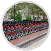 A Row Of Red Bikes Round Beach Towel by Eva Kaufman