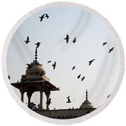 Round Beach Towel featuring the photograph A Whole Flock Of Pigeons On The Top Of The Ramparts Of The Red Fort In New Delhi by Ashish Agarwal