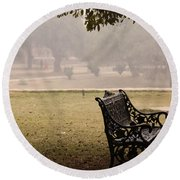 Round Beach Towel featuring the photograph A Wrought Iron Black Metal Bench Under A Tree In The Qutub Minar Compound by Ashish Agarwal