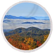 Round Beach Towel featuring the photograph Above The Clouds by Susan Leggett