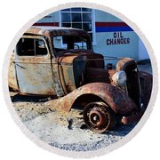 Round Beach Towel featuring the photograph ...and Rotate The Tires by Larry Bishop