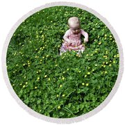 Baby In A Field Of Flowers Round Beach Towel