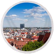 Round Beach Towel featuring the photograph Bratislava Roofs by Les Palenik