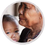 Round Beach Towel featuring the photograph Cambodian Grandmother And Baby #1 by Nola Lee Kelsey