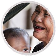 Round Beach Towel featuring the photograph Cambodian Grandmother And Baby #2 by Nola Lee Kelsey