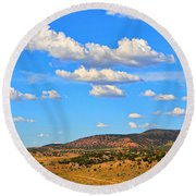 Cloudy Wyoming Sky Round Beach Towel