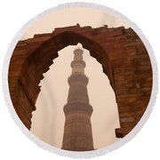 Cross Section Of The Qutub Minar Framed Within An Archway In Foggy Weather Round Beach Towel