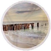 Evening Light Round Beach Towel by Nick  Shirghio