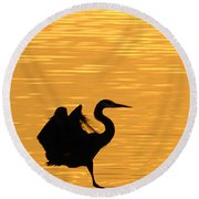 Round Beach Towel featuring the photograph Great Blue Heron Landing In Golden Light by Randall Branham