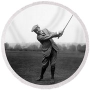 Round Beach Towel featuring the photograph Harry Vardon Swinging His Golf Club by International  Images