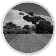 Round Beach Towel featuring the photograph Hillside Farmland by Kathleen Grace
