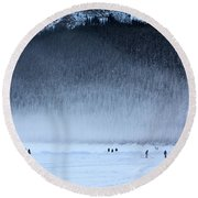 Round Beach Towel featuring the photograph Hockey On Lake Louise by Alyce Taylor