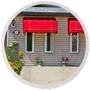 House With Red Shades. Round Beach Towel