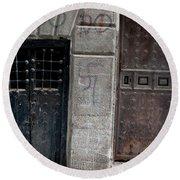 Round Beach Towel featuring the photograph Medieval Doors Evil Graffiti by Lorraine Devon Wilke