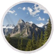Mountain Vista With Cliff Face And Blue Round Beach Towel
