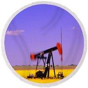 Oil Pumpjack In A Canola Field Round Beach Towel