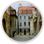 Round Beach Towel featuring the photograph Old Street In Bratislava by Les Palenik