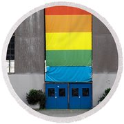 Round Beach Towel featuring the photograph Rainbow Banner Building by Kathleen Grace