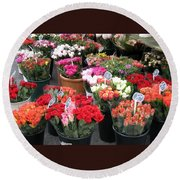 Round Beach Towel featuring the photograph Red Flowers In French Flower Market by Carla Parris