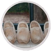 Rows Of Wooden Shoes Round Beach Towel by Carol Ailles