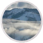 Round Beach Towel featuring the photograph Steamboat Ski Area In Clouds by Don Schwartz