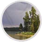 Storm Clouds Over A Lake Round Beach Towel by Anne Mott
