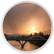 Sunburst Sunset Over Caveman Bridge Round Beach Towel by Mick Anderson