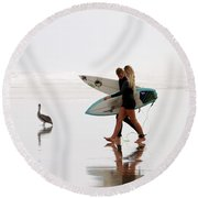 Round Beach Towel featuring the photograph Surfers And A Pelican by Alice Gipson