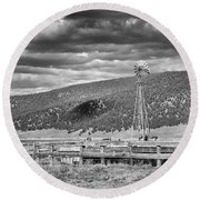 the lonly windmill in B and W Round Beach Towel
