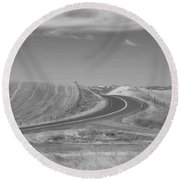 Round Beach Towel featuring the photograph The Quiet Road by Kathleen Grace