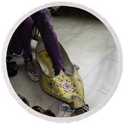 Round Beach Towel featuring the photograph Trying On A Very Large Decorated Shoe by Ashish Agarwal