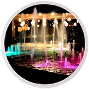 Water Fountain With Stars And Blue Green With Pink Lights Round Beach Towel