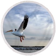 Round Beach Towel featuring the photograph White Pelican Flying Over Island by Dan Friend