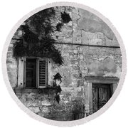Round Beach Towel featuring the photograph Crumbling In Croatia by Andy Prendy