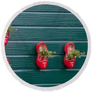 Wooden Shoes On Teh Wall Round Beach Towel by Carol Ailles