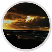 A Stormy Sunrise Round Beach Towel