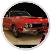 Round Beach Towel featuring the photograph 1969 Oldsmobile 442 W 30 by Chris Flees