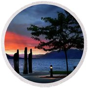 Round Beach Towel featuring the photograph A Sunset Story by John Poon