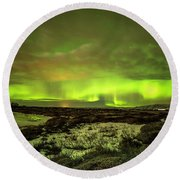 Aurora Borealis Over A Frozen Lake Round Beach Towel