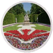 Flowerbeds And Sculptures In Eastern Parterre Round Beach Towel