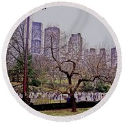 Round Beach Towel featuring the photograph Ice Skaters On Wollman Rink by Sandy Moulder
