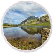 Round Beach Towel featuring the photograph Idwal Lake Snowdonia by Adrian Evans